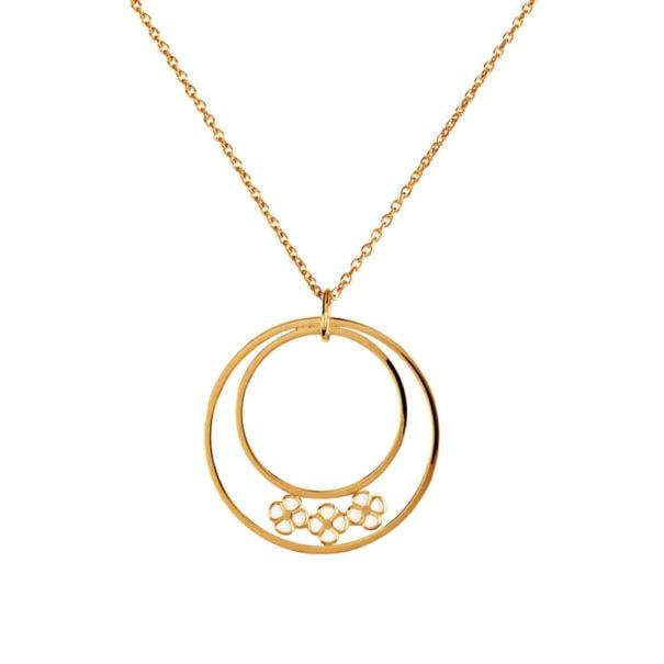 Collier fantaisie bali, zoom sur le pendentif doté de cercles et de fleurs