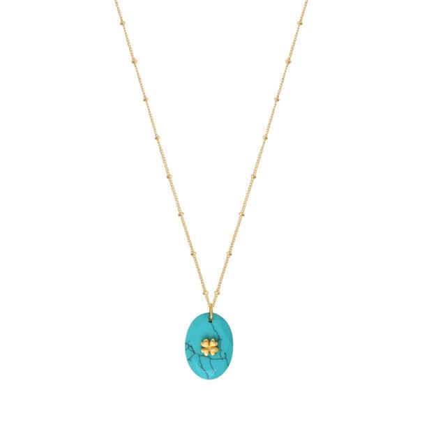 Collier au pendentif en pierre naturelle Turquoise. La chaîne est en plaqué or. En vente chez Poisson Plume