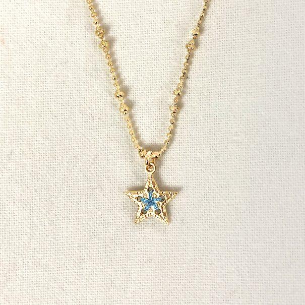 collier médaille étoile bleu ciel. une couleur exclusive pour la bijouterie de créateurs Poisson Plume
