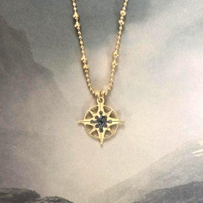 Collier rose des vents gris minéral argenté chez poisson plume bijoux