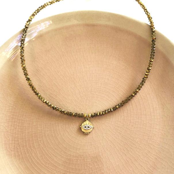 collier quartz médaille lyncée doré chez poisson plume