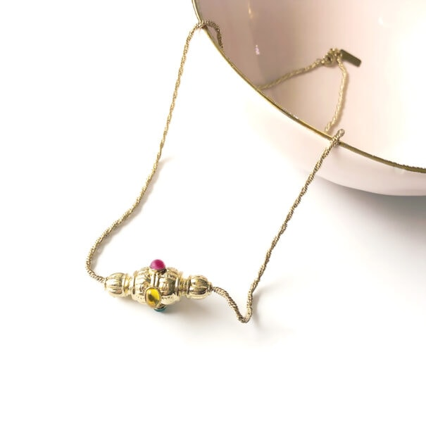 collier toupie moulin chez poisson plume bijoux