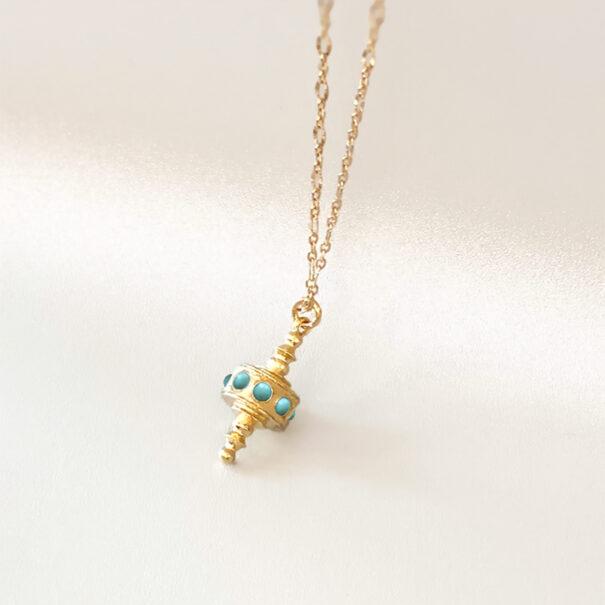 collier toupie turquoise chez poisson plume bijoux
