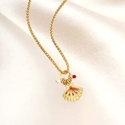 collier amulette cuivrée coquillage poisson plume