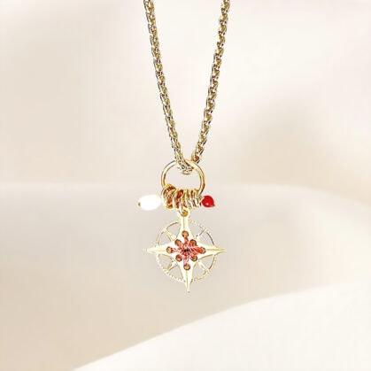 collier amulette rose des vents cuivrée chez poissonplume bijoux