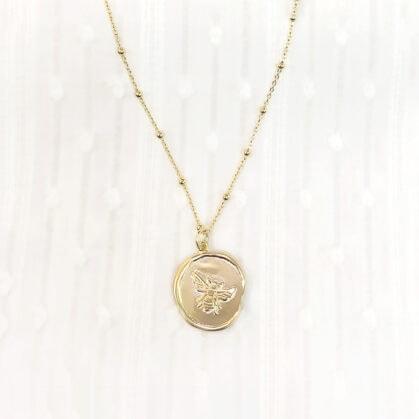 collier médaille melina chez poisson plume bijoux